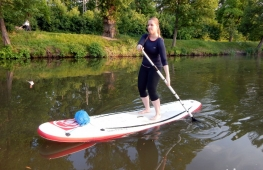 Try out stand up paddleboarding in Prague